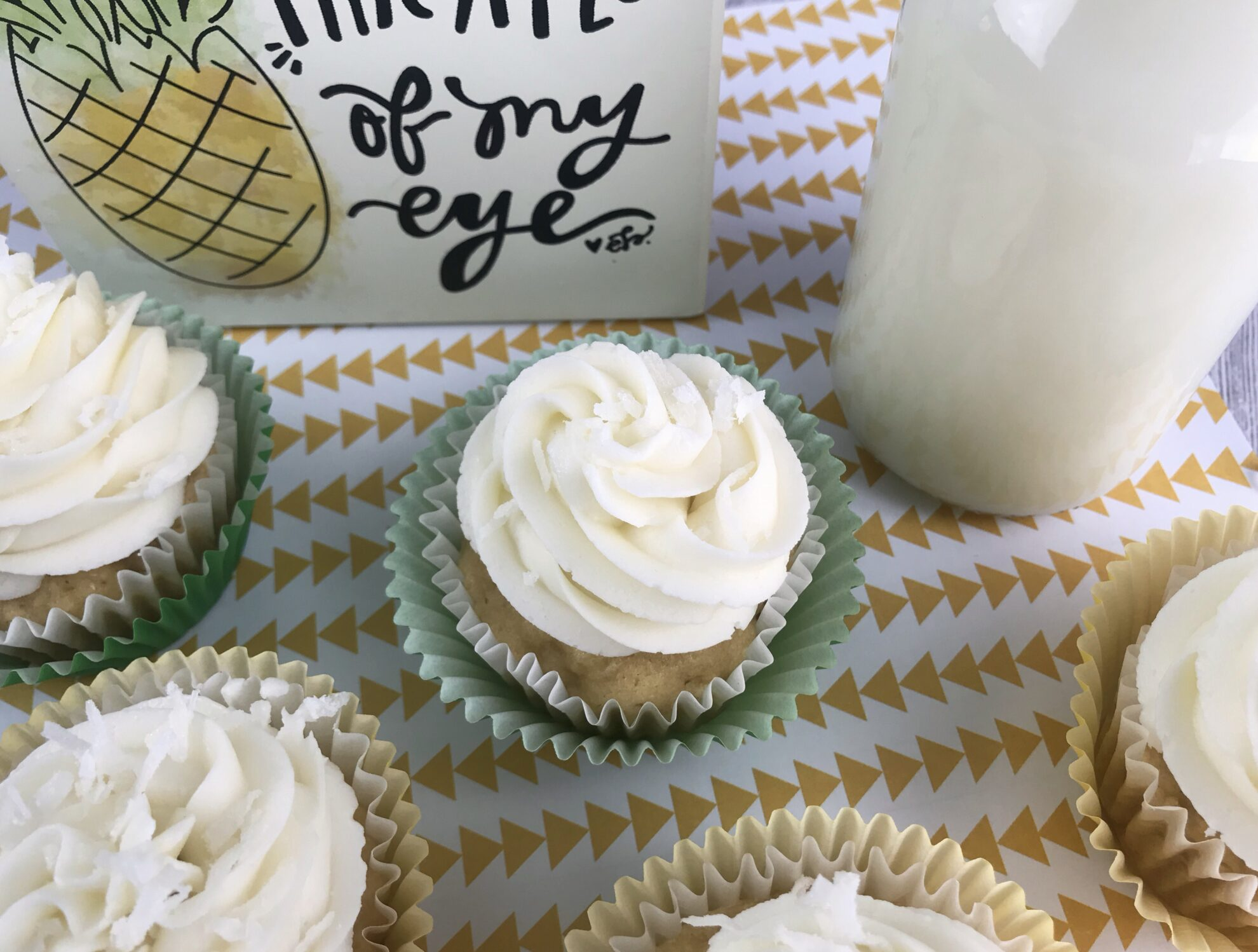 These Pineapple Cupcakes will whisk you away to the Tropics! The perfect refreshing dessert as a snack or for a birthday on 5DollarDinners!
