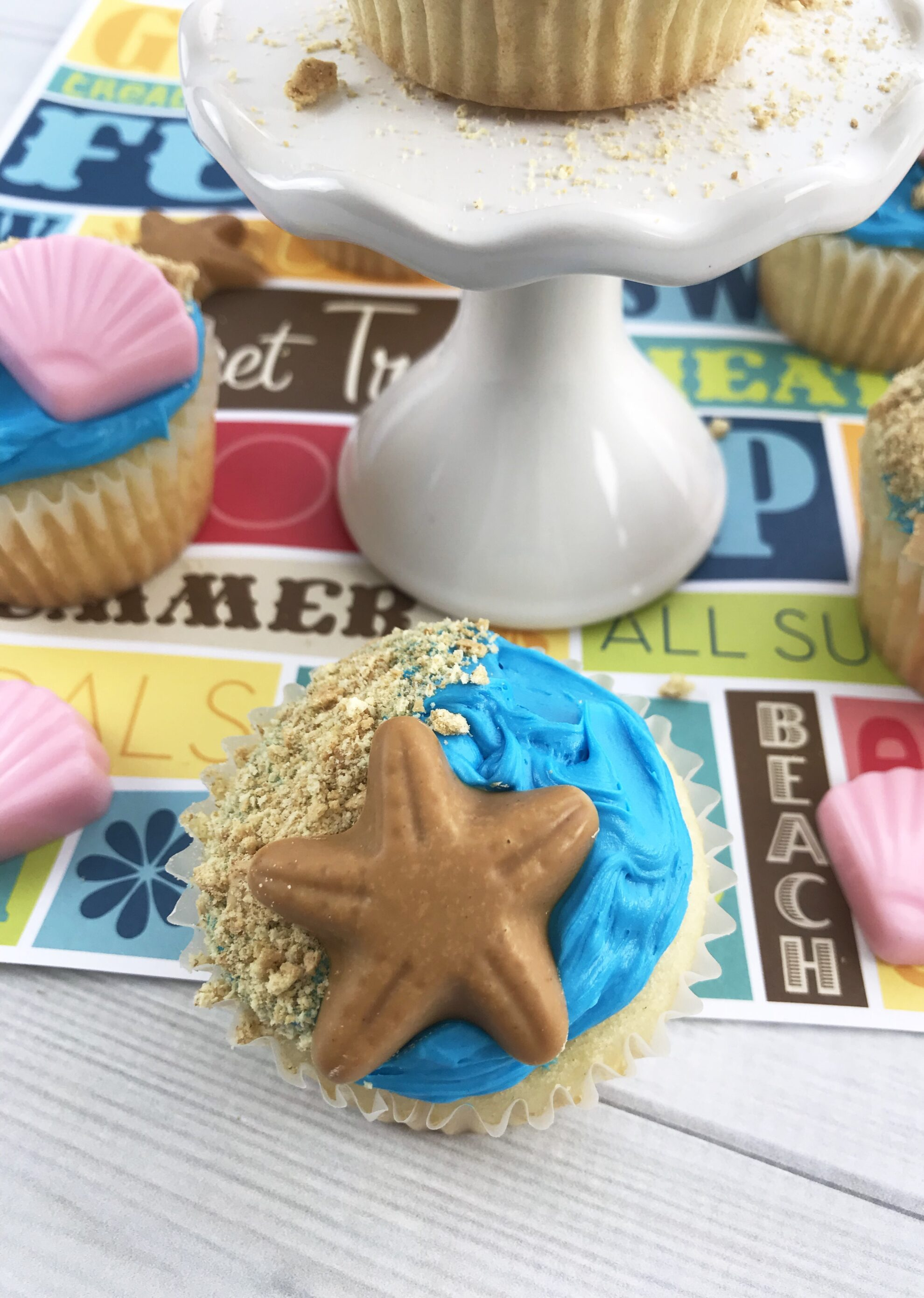 Summer is here and these Beachy Cupcakes are the perfect dessert to dish up for a BBQ or Party and the kids will love to help! Find these adorable treats on 5 Dollar Dinners!!